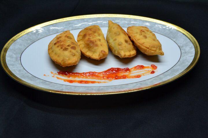 ricetta-ravioli-fritti-ripieni-di-salsiccia